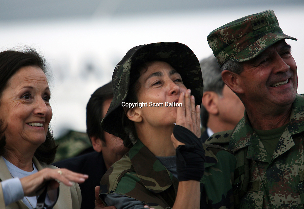 Ingrid Betancourt, who was help captive by FARC rebels for over 6 years, blows a kiss to the crowd as she is accompanied by her mother, Yolanda Pulecio, left, and General Mario Montoya, right, upon her arrival to Bogotá after being rescued in a Colombian military operation on July 2, 2008. (Photo/Scott Dalton).
