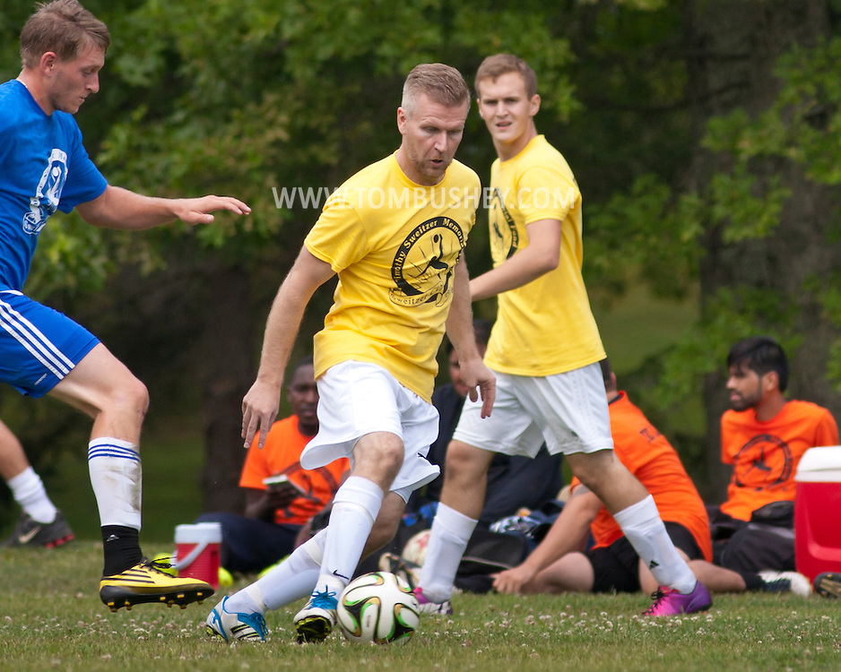 Goshen, New York -  Alumni soccer teams compete in the Sweitzer Cup benefit tournament on Aug. 2, 2014.