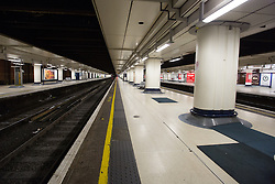 © Licensed to London News Pictures. 27/12/2013. London, UK. Empty train platforms at Victoria Railway station in London. Many National Rail services have been cancelled and disrupted as a result of very strong winds and rain. Southeastern Railways have cancelled all trains as a precaution until midday today and no rail services are running to Gatwick Airport this morning. Photo credit : Vickie Flores/LNP