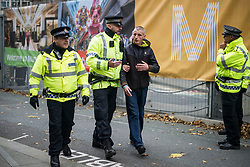 © Licensed to London News Pictures. 04/10/2017. Manchester, UK.  A protester is arrested during the demonstration on the final day of the Tory Party Conference. The protest was as part of the Take Back Manchester festival to protest the conference taking part in the city.  Photo credit: Steven Speed/LNP