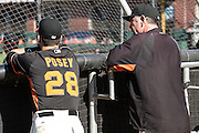 Bruce Bochy is chatting with Buster Posey, #28, during batting practice prior to the MLB game between the San Francisco Giants and the Colorado Rockies, at AT&amp;T Park in San Francisco, CA.<br /> The Rockies won 8-6 in 9 innings.<br /> Credit : Glenn Gervot