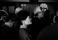 Church members standing for hours at a memorial ceremony for the 11 March 2011 earthquake and tsunami at the Russian Orthodox Church in Ishinomaki which was waste deep in sea water that day.  Ishinomaki, Miyagi Prefecture, Japan.