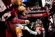 Washington Redskins quaterback Robert Griffin III acknowledges the fans as he leaves the field after the game against the Dallas Cowboys at FedEx Field in Landover, Maryland on December 28, 2014.  The Cowboys defeated the Redskins 44-17. UPI/Pete Marovich