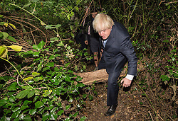© Licensed to London News Pictures. 30/07/2015. London, UK. The Mayor of London and MP for Uxbridge and South Ruislip Boris Johnson today visited the Wide Horizons Environment Centre in Bexley where he explored their new outdoor learning centre which was built by an 'army of volunteers' on a once derelict site. Photo credit : James Gourley/LNP