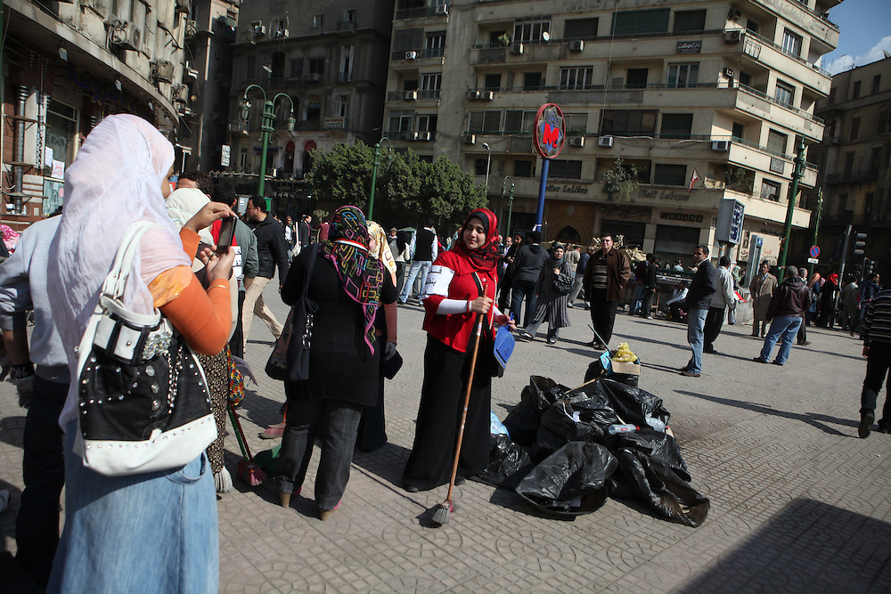 Volunteers help clean Tahrir Square two days after Mubarak was forced to step down as president.