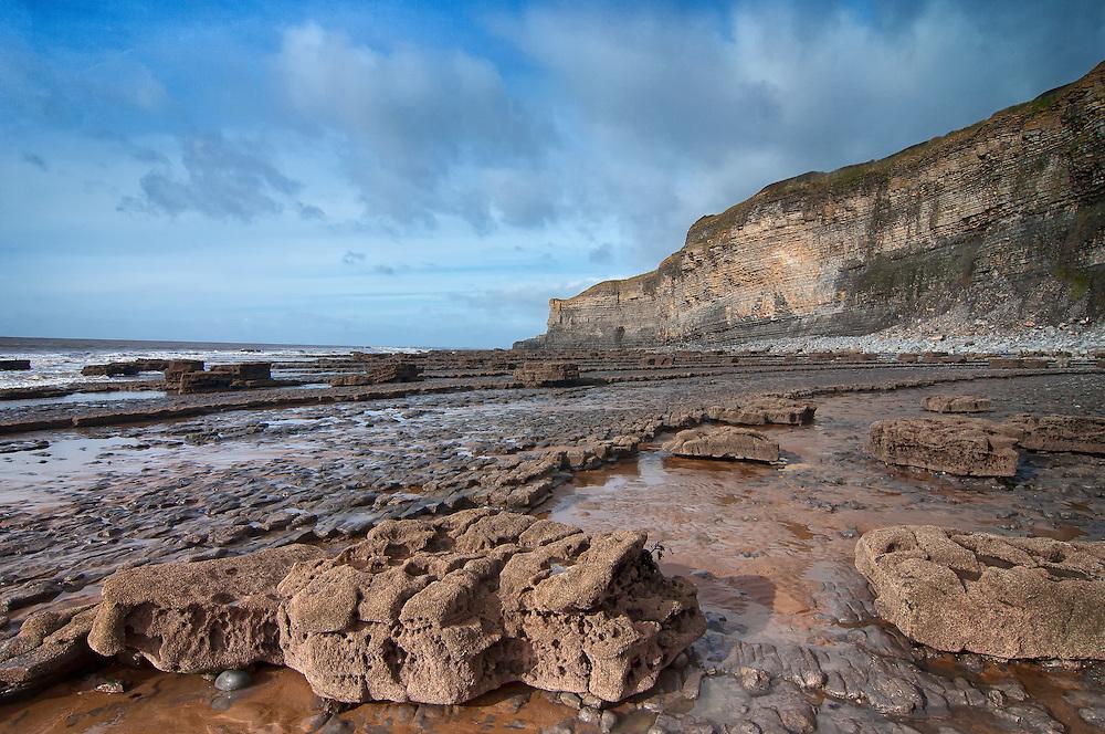 rocky beach facing cliffs