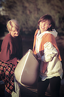 Women outdoors on location with canoe, casual, action portrait