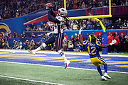 New England Patriots cornerback Stephon Gilmore (24) leaps and intercepts a late fourth quarter pass intended for Los Angeles Rams wide receiver Brandin Cooks (12) at the Patriots 4 yard line during the NFL Super Bowl 53 football game on Sunday, Feb. 3, 2019, in Atlanta. The Patriots defeated the Rams 13-3. (©Paul Anthony Spinelli)