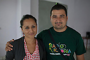 Radio Victoria members Marisela Ramos (left) and Elvis Zabala pose for a photograph after narrating the threats issued to the staff of their community radio station due to the station's involvement in the local anti-mining movement. Pacific Rim's controversial El Dorado gold mine has been the focus of numerous social conflicts at local and national level. Three anti-mining local leaders were murdered in 2009. While a year before, former president Antonio Saca refused to authorize the company's mining permit. This action prompted Pacific Rim to invoked a provision of the Central American Free Trade Agreement (CAFTA) to place the matter in the hands of an international arbitration court. Oceana Gold, who took over Pacific Rim on October 2013 for US $10.2 million , now seeks US $300 million for damages agains the State of El Salvador. Sensuntepeque, Cabañas, El Salvador. September 16, 2014.