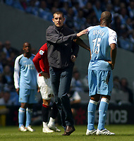 Photo: Paul Thomas.<br /> Manchester City v Manchester United. The Barclays Premiership. 05/05/2007.<br /> <br /> A drunk City fan runs onto the pitch during the game and pats Sylvian Distin on the back.