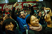 Caption: The excited audience shouts to support its favorite wrestler in the wrestling match in El Alto, Bolivia, February 19, 2012.