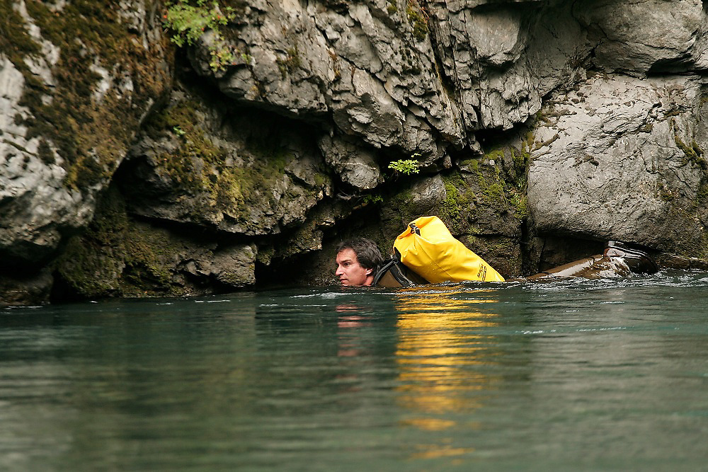 Fish biologist Sam Brenkman, of the National Park Service, swims in the Elwha River, in Olympic National Park, Washington. The research is a collaborative effort between the National Park Service and other agencies to establish a baseline of fish distribution and habitat structure for the entire river before the removal of the upper and lower dams, scheduled for 2012.