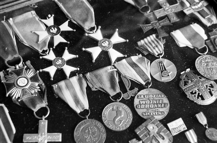 Some of the medals received by Eugeniusz Ajewski, KOTWA..Before the war Kotwa was a student of architecture. As a young but experienced soldier he motivated the boys in Mokotów district. In 1940 he already leaded as many as 40 trained soldiers..Before the Uprising he had been working in the railway station building barracks for the Germans. Later, as a brave insurgent involved in very risky missions, he will be back in those areas setting explosive charges and destroying the Nazi shelters he had built few mounths before..Defender of the redoubt MAGNET, he took part in the capture of the SGGW building (University) in Mokotów district where the Germans had other barracks. The building was captured with the use of grenades and just one single gun. Seventeen of his soldiers died in this operation..Following orders, he moved back to organize the guerrillas in the forest..After the capitulation, he ran away from the convoy which was leading him to the prisoner-of-war camp..After the war, he became one of the most important architects of Warsaw. He rebuilt the destroyed Lazienkowski Palace and built 3600 cheap, single-family houses for the middle class and also 8 memorials commemorating the fight of AK (Home Army) soldiers..