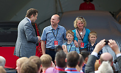 LONDON, ENGLAND - Saturday, June 7, 2014: CEO & Chief Product Architect Elon Musk hands over they keys to the UK's first customer of the Model S Jonathan Grant at the UK launch of Tesla Motors' Model S electric car at the Crystal. (Pic by David Rawcliffe/Propaganda)