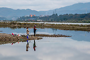 Residents fish in the Lancang (Mekong) river near Manhenuan village, Xishuangbanna, China.