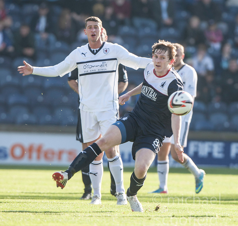 Raith Rovers Calum Elliot and Falkirk's Blair Alston.<br /> Raith Rovers 1 v 1 Falkirk, Scottish Championship 28/9/2013.<br /> &copy;Michael Schofield.