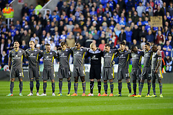 The Leicester City players stand for a minutes silence before the match to mark the 25th anniversary of the Hillsborough disaster - Photo mandatory by-line: Rogan Thomson/JMP - 07966 386802 - 14/04/2014 - SPORT - FOOTBALL - Madejski Stadium, Reading - Reading v Leicester City - Sky Bet Football League Championship.