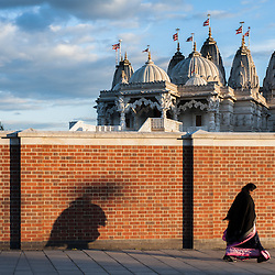 A Hindu woman arrives at The BAPS Shri Swaminarayan Mandir, also referred to as Neasden Temple, before the celebrations of Swaminarayan Jayanti at Neasden Temple in London.