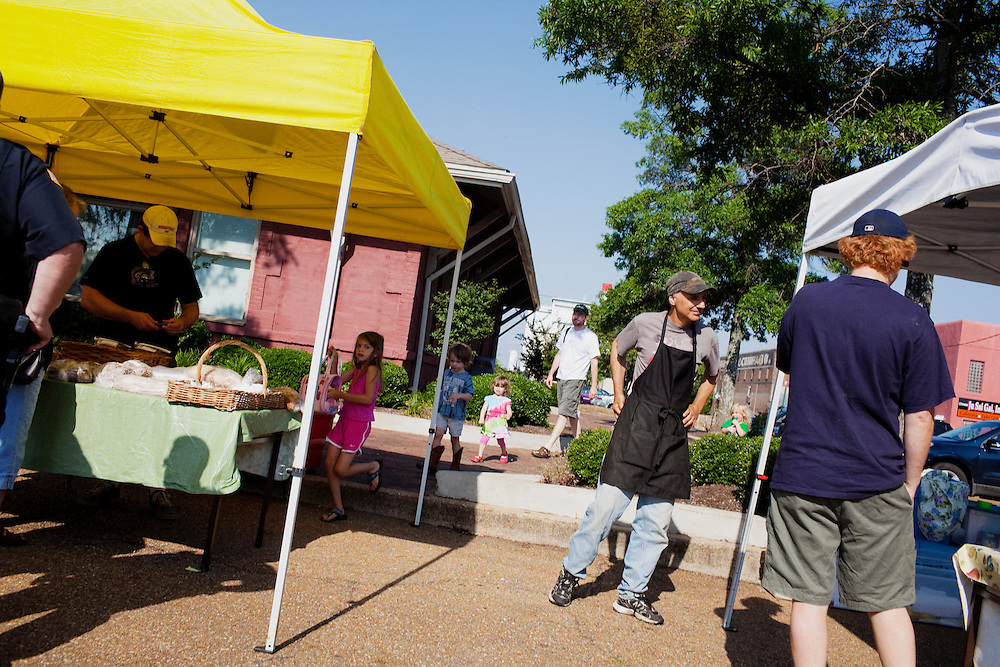 Residents and visitors flock to the farmer's market in Greenwood, Mississippi on Saturday, May 28, 2011.