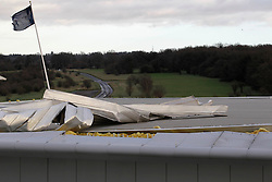 © Licensed to London News Pictures. 03/01/2012, London, UK.  The grandstand roof of Epsom Down race course in south London is being partly blown apart by high wind as stormy weather hit part of UK, Tuesday, Jan. 3, 2012. Photo credit : Sang Tan/LNP
