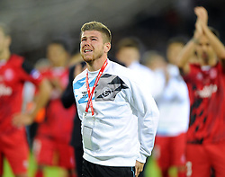 Sevilla's Alberto Moreno is in tears as he says his final good bye to team mates and Seville fans aged of his move to Liverpool - Photo mandatory by-line: Joe Meredith/JMP - Mobile: 07966 386802 12/08/2014 - SPORT - FOOTBALL - Cardiff - Cardiff City Stadium - Real Madrid v Sevilla - UEFA Super Cup