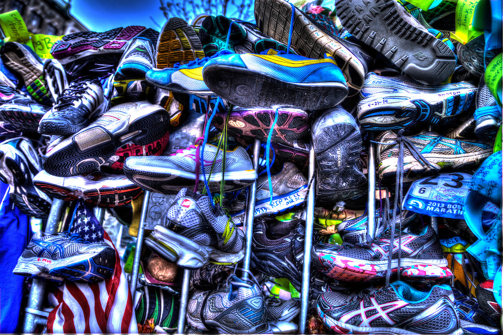 Runners shoes at the people's memorial in Copley Square, Boston after the April 15, 2013 Boston Marathon Bombing.