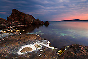 Rocky sea shore at a dusk hour