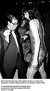 Bob Collacello dancing with Anjelica Huston at Vanity Fair magazine's Phoenix House benefit. Los Angeles. March 1990.<br />