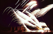 Death Valley, California. 4th of July celebration fireworks at Furnace Creek in high winds. 100 degrees F at 10 PM. Palm trees caught on fire and burned when struck by fireworks.