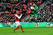 Claudio Bravo (1) of Manchester City leaps up to claim the ball as Pierre-Emerick Aubameyang (14) of Arsenal bears down on him during the EFL Cup Final match between Arsenal and Manchester City at Wembley Stadium, London, England on 25 February 2018. Picture by Graham Hunt.