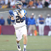 John Haus #26 of the Charlotte Hounds controls the ball during the game at Harvard Stadium on May 17, 2014 in Boston, Massachuttes. (Photo by Elan Kawesch)