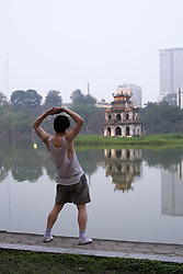 Evening Tai Chi exercises at Hoan Kiem Lake in Hanoi Vietnam