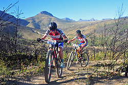 WELLINGTON SOUTH AFRICA - MARCH 23: Women's Africa Jersey wearers Amy Beth and Candice Lill during stage five's 39km time trial on March 23, 2018 in Wellington, South Africa. Mountain bikers gather from around the world to compete in the 2018 ABSA Cape Epic, racing 8 days and 658km across the Western Cape with an accumulated 13 530m of climbing ascent, often referred to as the 'untamed race' the Cape Epic is said to be the toughest mountain bike event in the world. (Photo by Dino Lloyd)