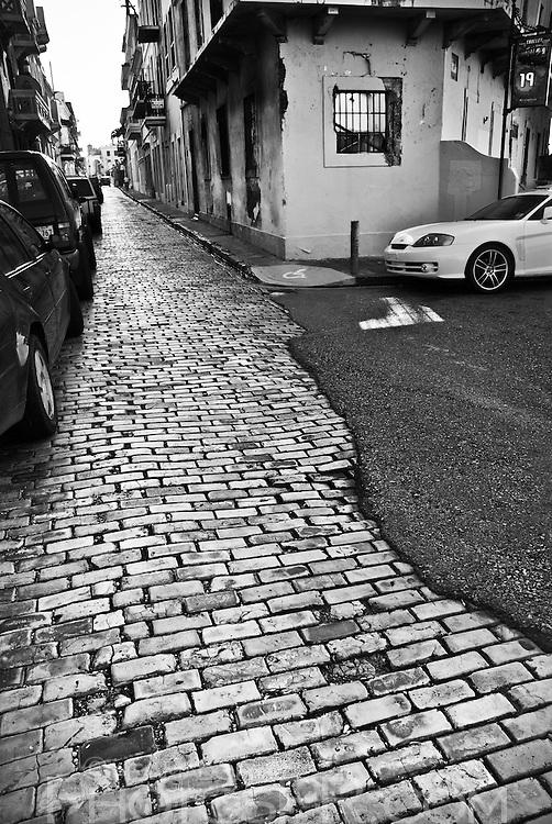 Cobblestoned street partly covered on asphalt