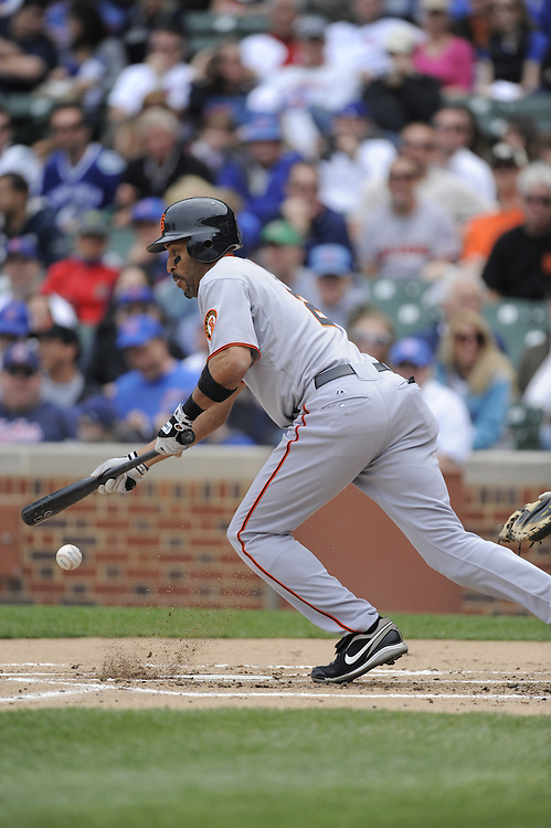 CHICAGO - MAY 05:  Randy Winn #2 of the San Francisco Giants bunts against the Chicago Cubs on May 5, 2009 at Wrigley Field in Chicago, Illinois.  The Giants defeated the Cubs 6-2. (Photo by Ron Vesely)