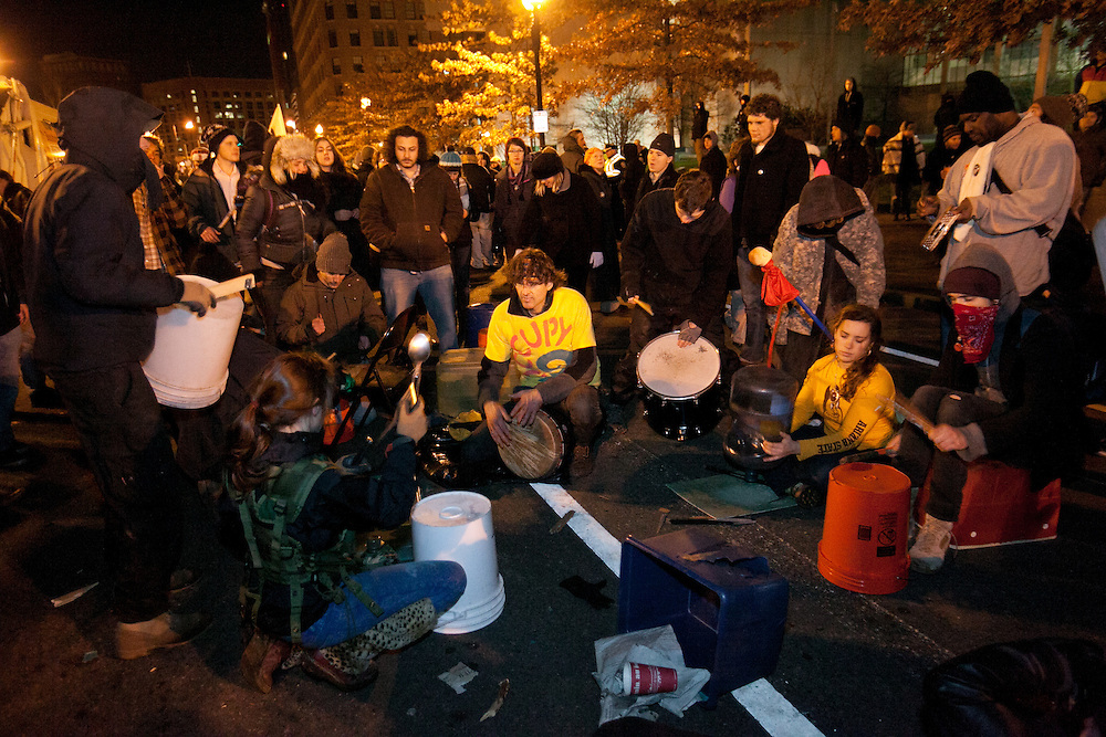 Boston, MA 12/09/2011.Occupy Boston protestors sit in a drum circle after the passing of the city's deadline to vacate Dewey Square early Friday morning..Alex Jones / www.alexjonesphoto.com