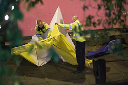 "© Licensed to London News Pictures . 06/10/2013 . Manchester , UK . Police erect a forensic tent at the scene . Police pull a body from The Bridgewater Canal in Manchester , adjacent to the City's "" Gay Village "" . The body was spotted yesterday (6th October) afternoon and a cordon was erected as specialist police divers made the recovery . Photo credit : Joel Goodman/LNP"