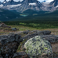 Lichen covered boulder and Chrome Lake. Tonquin Valley, Jasper National Park, Alberta, Canada.