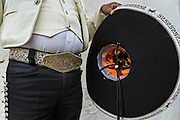 Cowboy belt buckle and sombrero of a Mexican mariachi dressed in traditional charro costume November 5, 2013 in Oaxaca, Mexico.