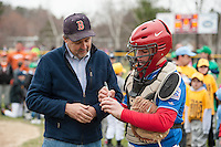 """Majors Rotary catcher Tyler Richter signs the """"first pitch"""" ball for Mayor Ed Engler during Laconia Little League Opening Day festivities at Colby Field Saturday morning.   (Karen Bobotas/for the Laconia Daily Sun)"""