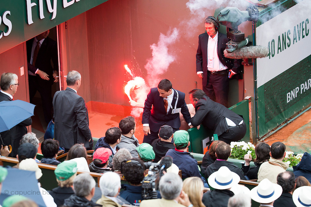 Paris, France. Roland Garros. June 7th 2013.<br /> Protesters try to get on the court during the French Open Final opposing Rafael NADAL and David FERRER