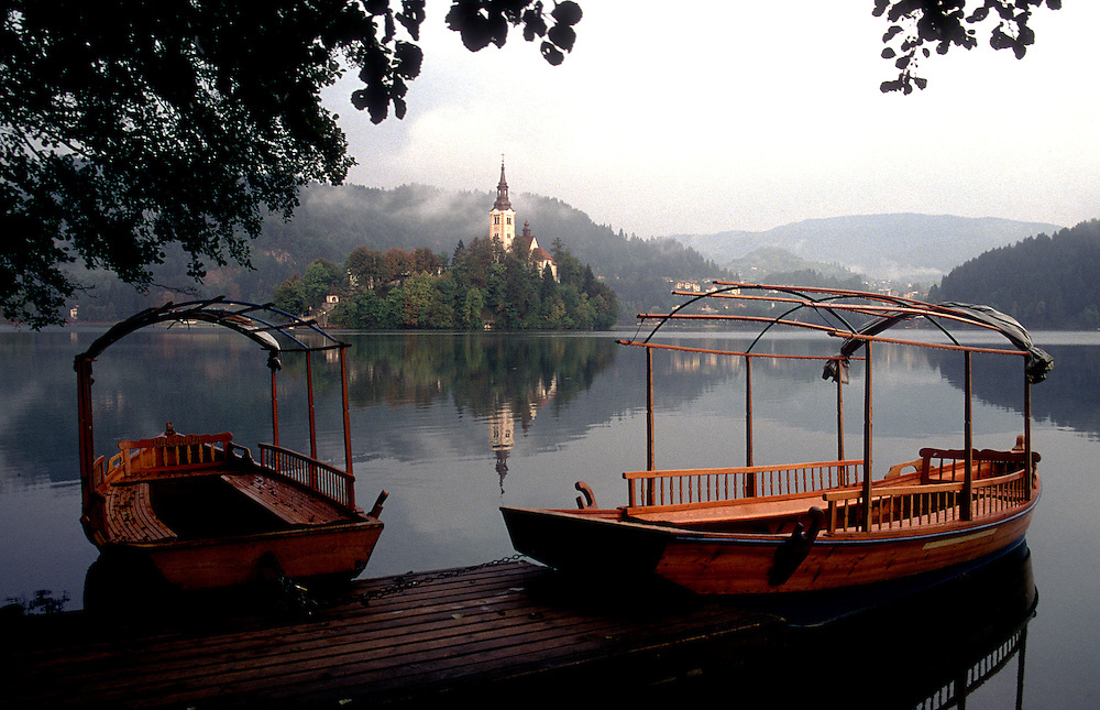Bled, Slovenia: A small characteristic boat called a<br /> pletna awaits passengers to the tiny island in the center of Lake Bled.