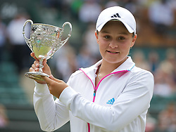 03.07.2011, Wimbledon, London, GBR, WTA Tour, Wimbledon Tennis Championships, Finale, im Bild Ashleigh Barty (AUS) celebrates with the trophy after winning the Girls' Singles Final match on day thirteen of the Wimbledon Lawn Tennis Championships at the All England Lawn Tennis and Croquet Club. EXPA Pictures © 2011, PhotoCredit: EXPA/ Propaganda/ David Rawcliffe +++++ ATTENTION - OUT OF ENGLAND/UK +++++