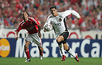 Photo: Lee Earle.<br /> Benfica v Manchester United. UEFA Champions League, Group F. 26/09/2006. United's Cristiano Ronaldo (R) is tracked by Leo.