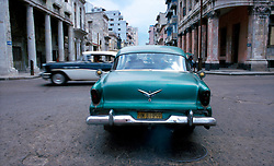 Vintage American automobiles, left behind by those fleeing Castro's revolution, are a common site in Havana and throughout Cuba. (Photo © Jock Fistick)