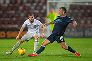 Scott McDonald (#10) of Partick Thistle FC gets to the ball ahead of Benjamin Garuccio (#17) of Heart of Midlothian during the William Hill Scottish Cup quarter final replay match between Heart of Midlothian and Partick Thistle at Tynecastle Stadium, Gorgie, Edinburgh Scotland on 12 March 2019.