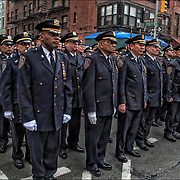 NYPD Auxiliary force honors fallen officers 11 years after they were tragically gunned down in Greenwich Village.<br /> <br /> Tragic death of  NYPD Auxiliary officers Eugene Marshalik, 19, and Nicholas Pekearo, 28, were on patrol on March 14, 2007, when they confronted deranged wannabe movie director David Garvin.<br /> <br /> Relatives of the officers and scores of auxiliary police officers walked down Bleecker Street, the procession ended at the intersection of Sullivan and Bleecker Sts., where the corner was named after Marshalik and Pekearo.<br /> <br /> The deaths of the auxiliary officers 11 years ago stunned the city and led to the purchasing of bullet proof vests for members of the NYPD&rsquo;s auxiliary &mdash; unpaid civilian volunteers who aim to deter crime by acting as the &ldquo;eyes and ears&rdquo; of the NYPD and providing a uniformed presence.