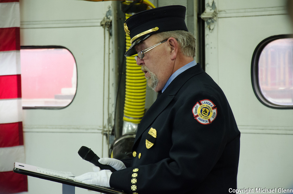 10Jun2013/Lanoka Harbor/NJ/USA/Funeral Service for LHFD Chief Kevin Perrone who died suddenly after a battle with Kidney failure. Mike Nugent speaks to the Perrone family