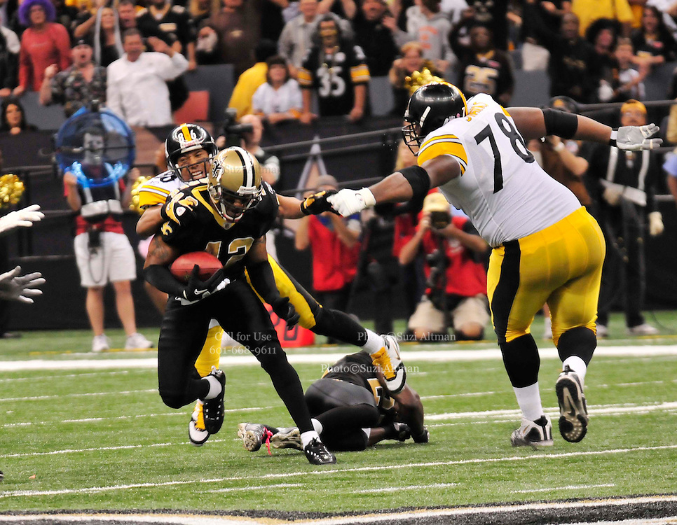 The New Orleans Saints safety Darren Sharper (42) snatches a pass from Ben Roethlisberger for an interception that leads to a New Orleans Saints touchdown during the 4th quarter of the game against the steeleres. play the Pittsburgh Steelers in New Orleans at the SuperDome in Louisiana on Halloween Oct.31 2010. The Saints went on to win 20 -10 in a very physical game. Photo©SuziAltman.