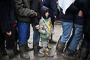 A young boy waiting in line for a food distribution in the Grande Synthe refugees camp where about 1500 persons live, France. FEDERICO SCOPPA/CAPTA